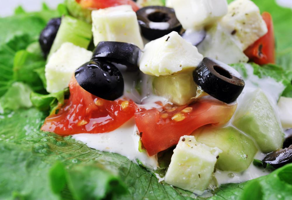 Greek salad with feta, cucumbers, and romaine lettuce.