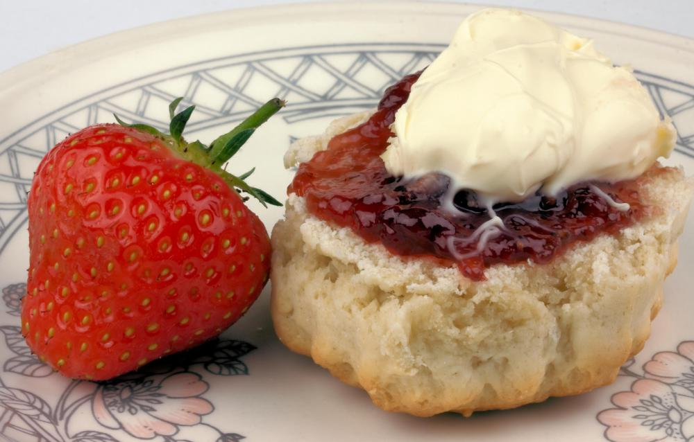 Scones are often served with clotted cream, berries, and jam.