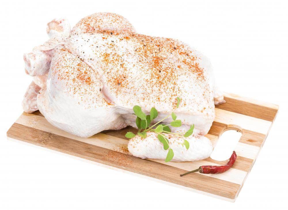 Roast chicken with spices and herbs is a staple in French bistro cuisine.