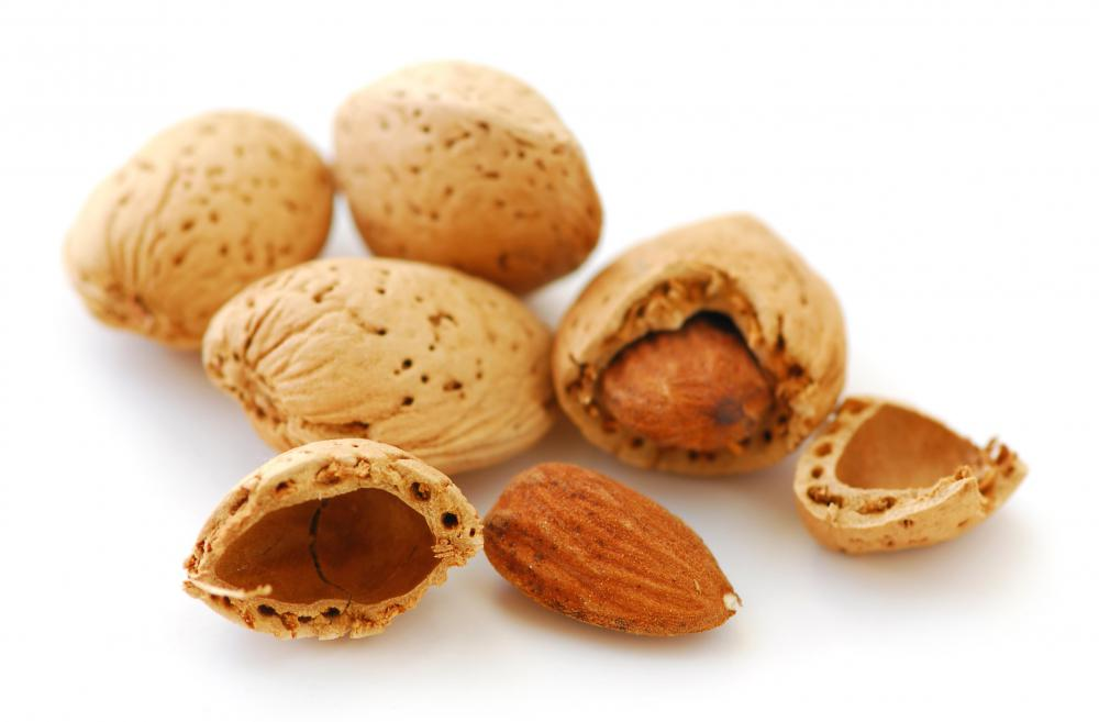 Shelled and whole almonds.