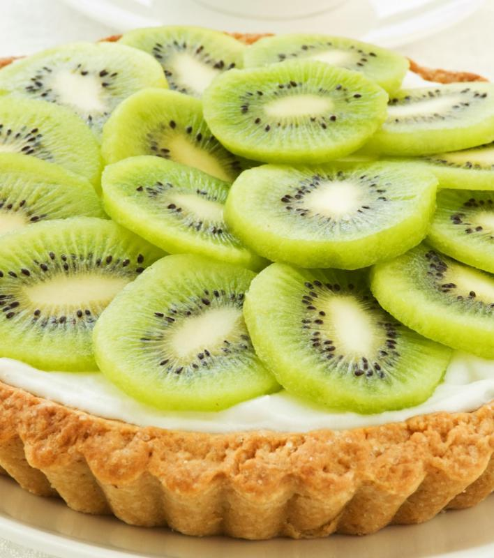 Sliced kiwi on a kiwi tart.