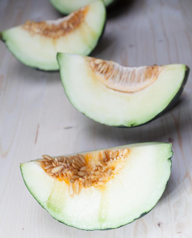 The seeds and pulp should be scooped out of the slices of a Christmas melon before eating.