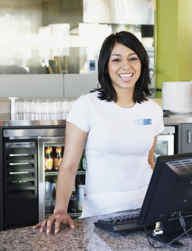 At a small cafe or restaurant, the hostess may not only greet and seat customers but also run the cash register.