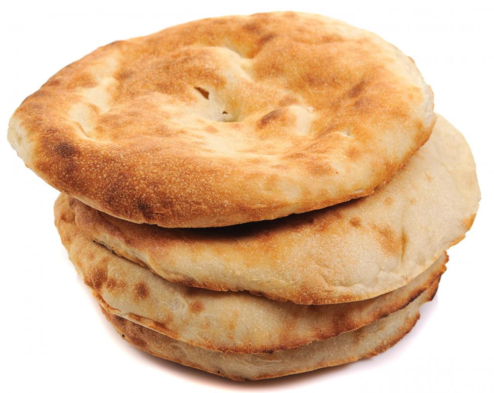 A stack of fresh pita bread which is used in making gyro sandwiches.