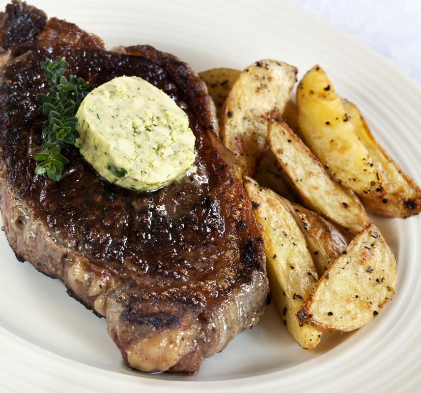 Steak with truffle butter and steak fries.