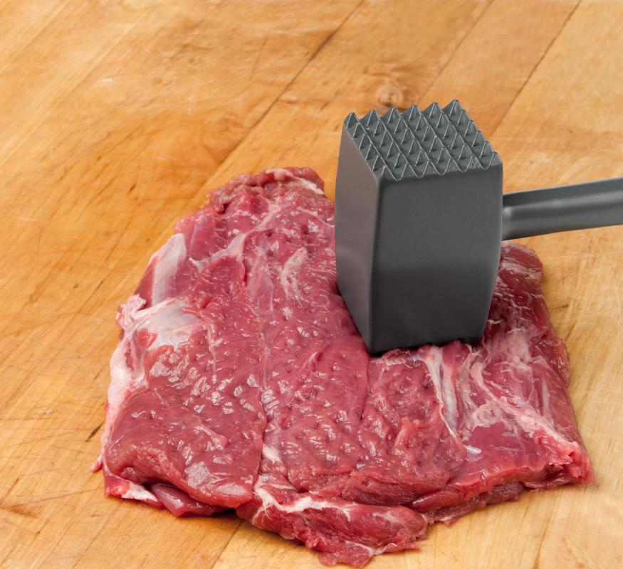 A piece of minute steak with a mallet.