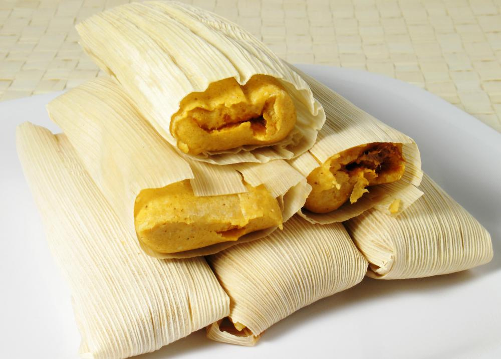 Corn husks or corn leaves are often used to wrap tamales.