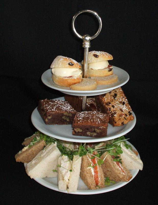 A variety of small snacks are offered at high tea.