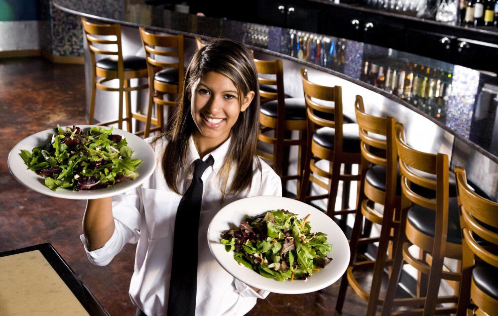 Waiters and waitresses are now often called servers, a more gender neutral term.