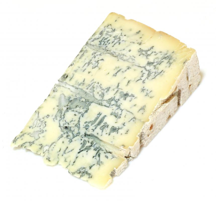 Wedge of gorgonzola cheese, which is often included in Mexican white sauce.