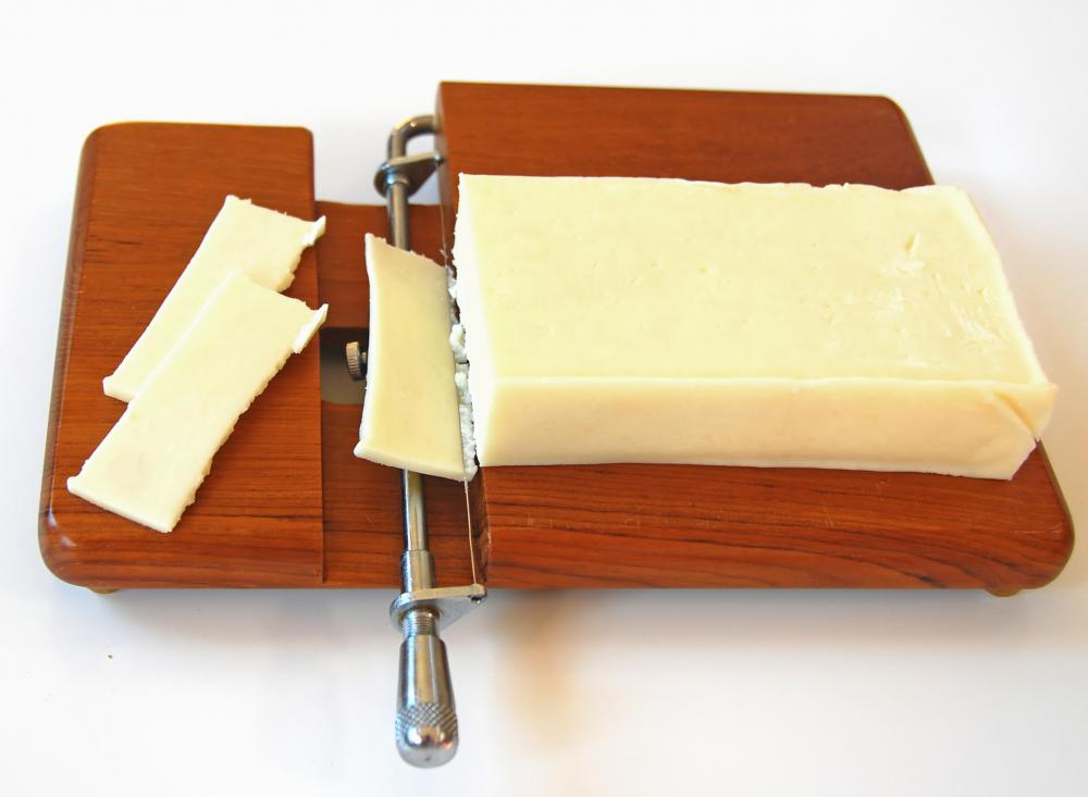 A block of Monterey Jack cheese.