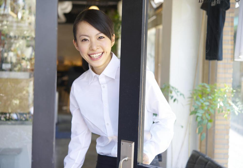 A hostess typically greets customers upon arrival.